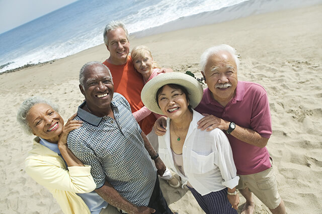 STOCK-PHOTO-Senior-Couple-Group-on-Beach 640